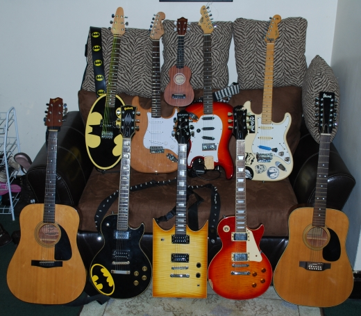 All of my guitars & the wife's ukulele