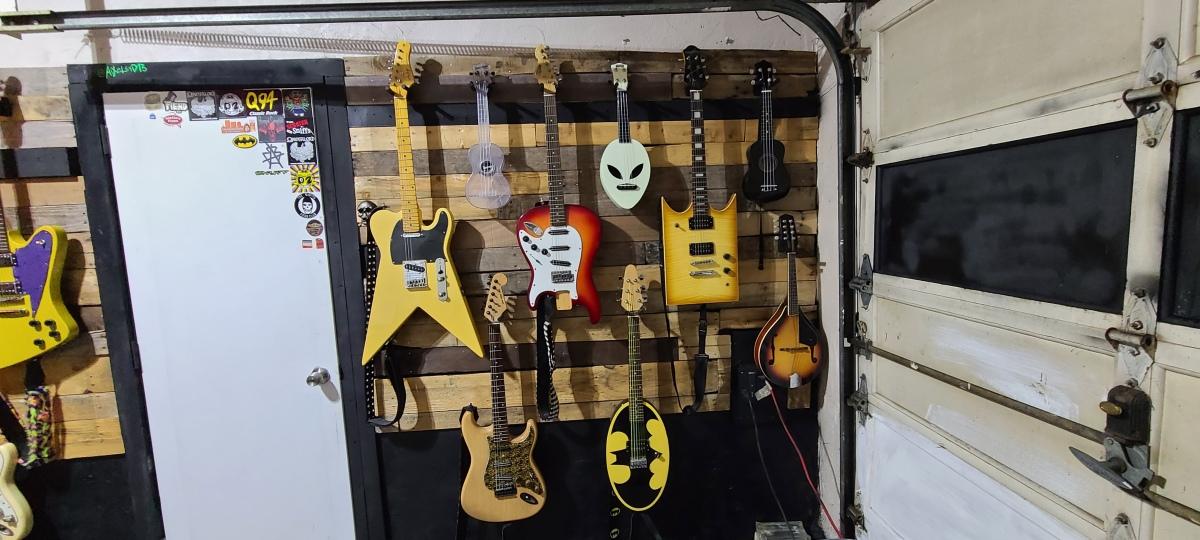 AiXeLsyD13's guitars - Right of the door.
