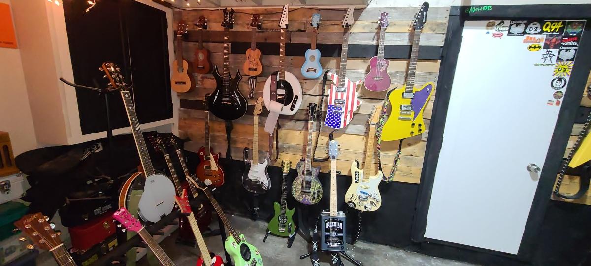 AiXeLsyD13's guitars - Left of the door.